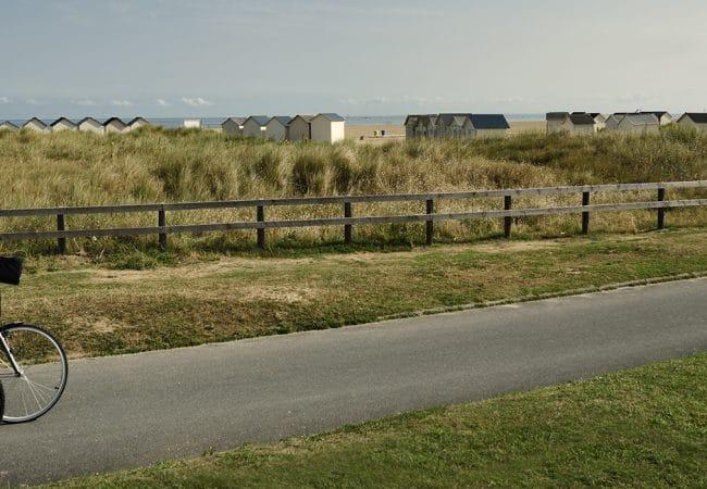 Couple cycling along the Calvados coast
